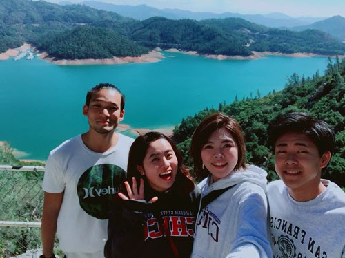ALCI students smile for the camera with Lake Shasta in the bakcground