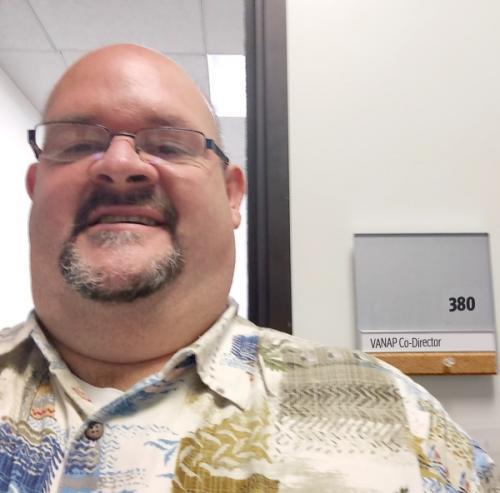 Photo of RN-BSN Program Graduate Paul Ortiz