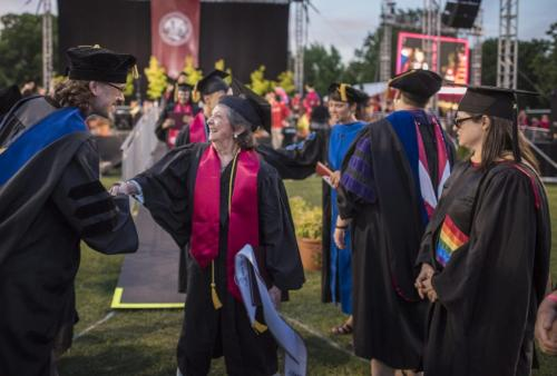 Sylvia Hamilton is congratulated by faculty after earning her bachelor's in sociology through Chico State's online degree completion program.