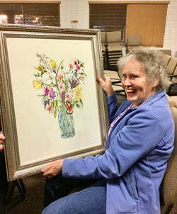 OLLI Member Joan Palmer Wins an Original Painting by Susan Proctor at the OLLI Gallery Opening on November 28, 2017