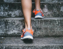 Photos of feet in sneakers walking up stone steps