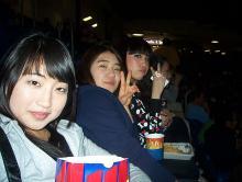 Students enjoying snacks at the basketball game